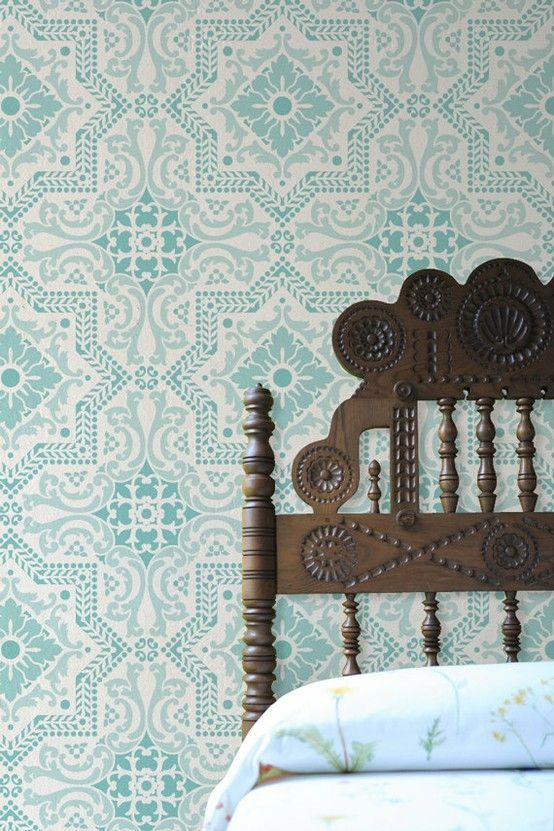 Mosaic inspired wallpaper and beautiful carved bed head
