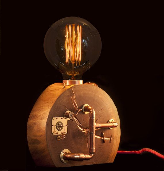 This one of a kind piece of functioning art will give your home a romantic atmosphere with its warm orange light.  Base of lamp is made from