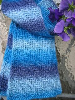 Inspired by/modified from Knitting Kninja's Dapper Herringbone Scarf, this scarf was designed to show off handpainted or variegated yarns, breaking up random mixtures of hues into strong, slanting rays of color.
