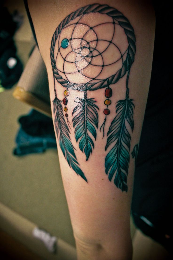 charming-dream-catcher-tattoo-on-arm
