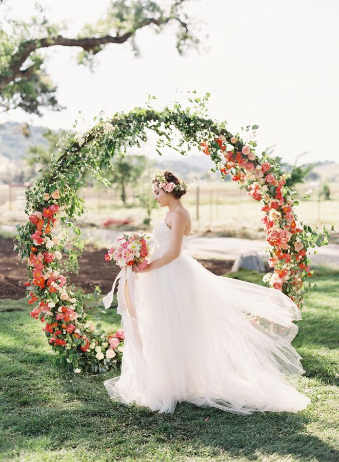 Circular floral-filled arch: http://www.stylemepretty.com/2016/06/09/weve-found-the-girly-wedding-inspo-of-your-dreams/ | Photography: Caroline Tran - http://carolinetran.net/
