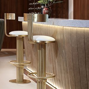 Kelly is a bar stool inspired in the curved and sculpted arches from the bar in the classic movie Casablanca. The body is a full piece of polished brass and features a low black, a foot rail and brown leather on the seat. Besides being stylish, it is made to endure and be comfortable at the same time. We'll always have Kelly?