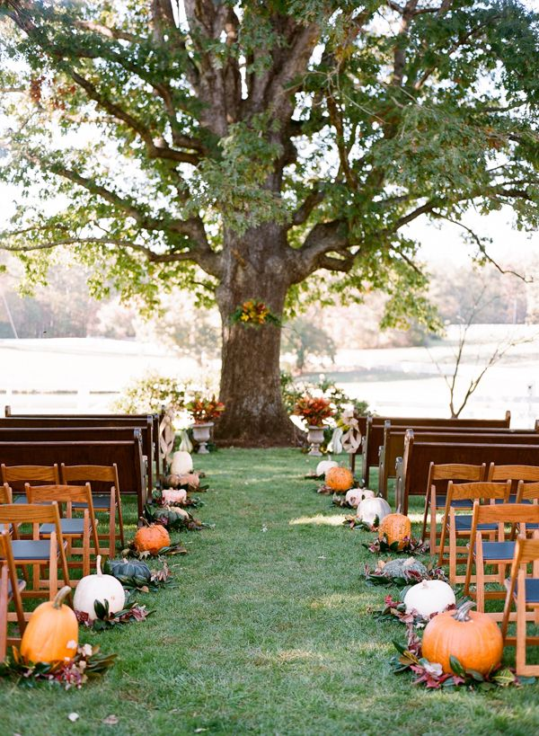Planning a fall wedding? We're falling for this pumpkin-lined aisle. Question is, to carve or not to carve?