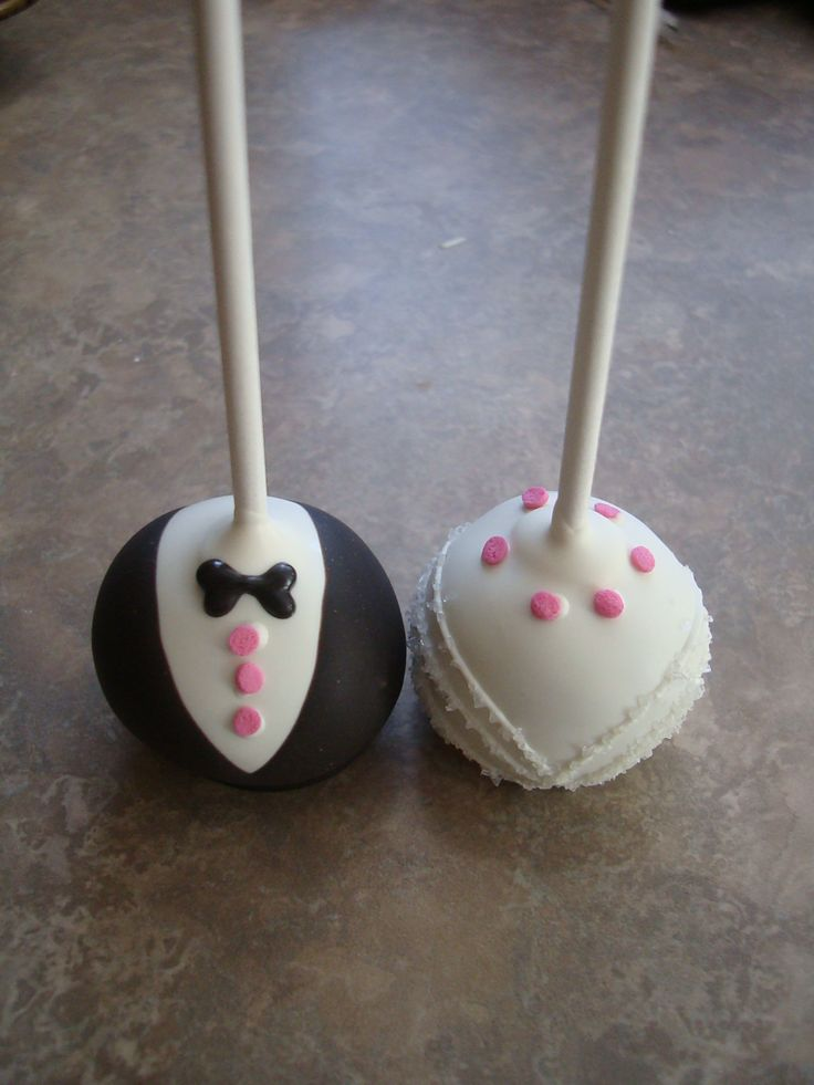 Rehearsal dinner cake pops. Groom is chocolate cake, chocolate buttercream and the bride is vanilla cake and vanilla buttercream.