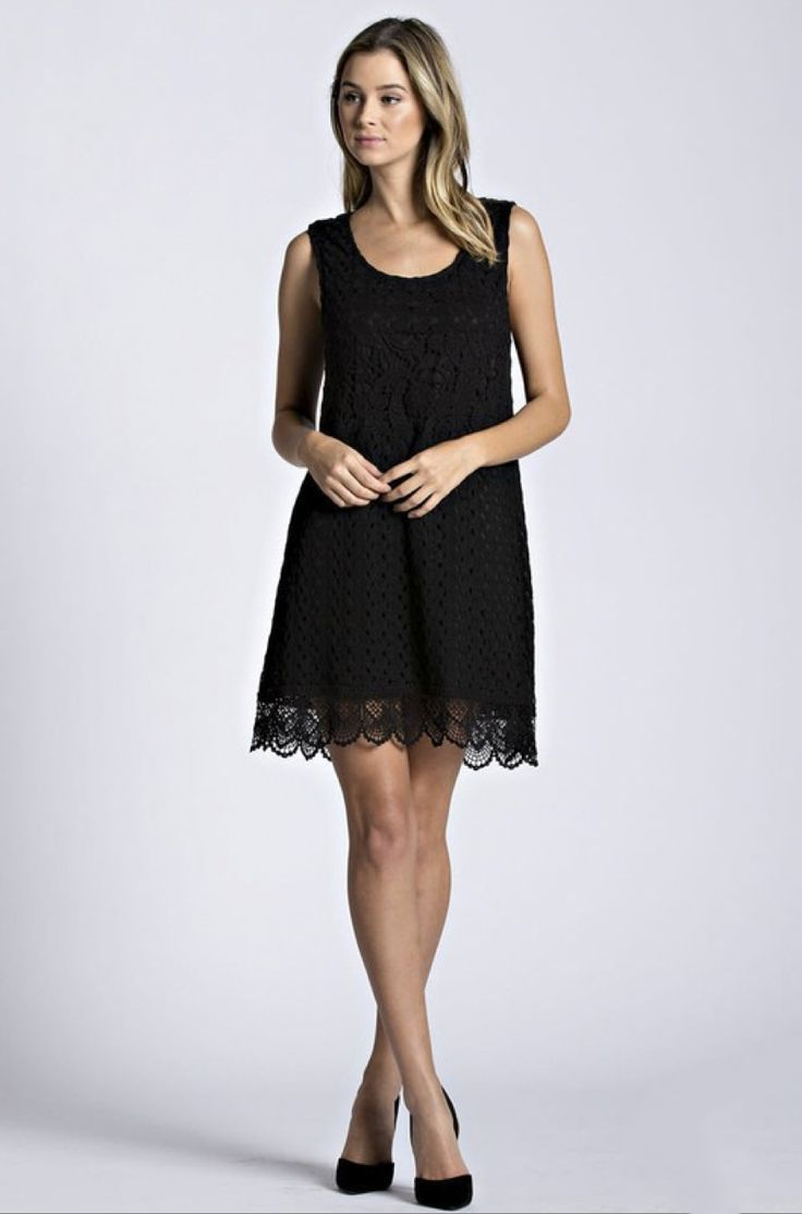 This lace shift dress features contrasting lace details & a peek-a-boo hemline. The classic design gives this dress an effortless fit, while the lace & sweet buttoned keyhole back accent add romantic