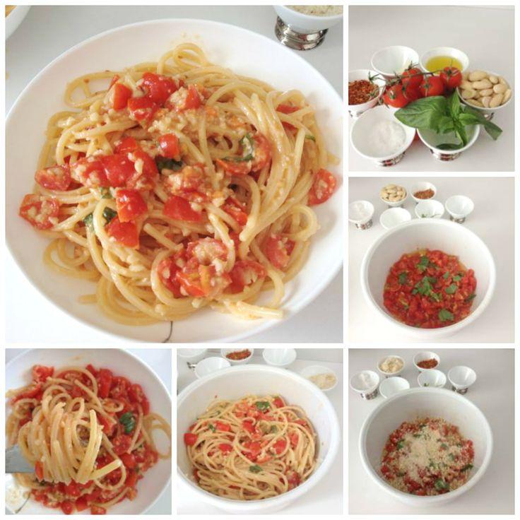 Spaghetti con pesto alla trapanese. Spaghetti with trapanese pesto sauce: tomatoes, almonds, basil, oil and chili.