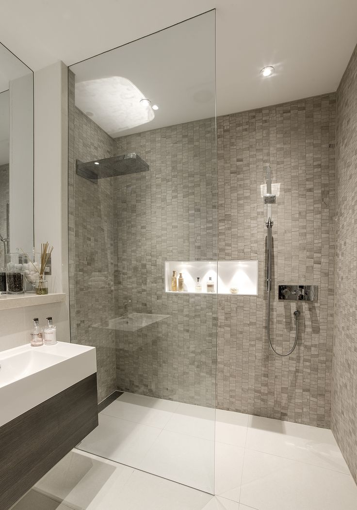 If shower sprays towards opening, where does the spray go?