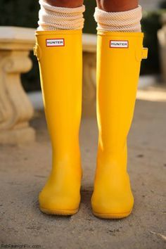 Yellow rain boots (or Wellies, short for Wellington), as they say in Great Britain.  The name is almost as fun as the boots. They are named for Arthur Wellesley, 1st Duke of Wellington. (I thought I would thrown in this minutia, in case this question ever pops up on Jeopardy!)  giggles  I think if I owned these, I would pray for rain every day!  ;) ...or just move to London. The closest thing to a bright, sunny day there , is a parade of fashionistas strolling past them, all adorned in this…