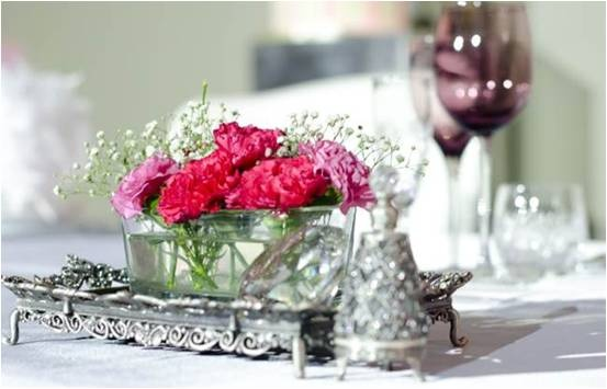 Flower arrangement vased on a classic silver piece for the vintage wedding - decor by D'Masque