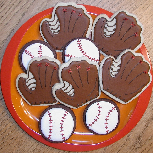 These are some cookies I made for a kickoff potluck for my son's high school baseball program. I made 3 dozen mitts and 5 dozen baseballs.     http://advertiseyourbizonline Social Media Marketing Manager - Graphics and more.