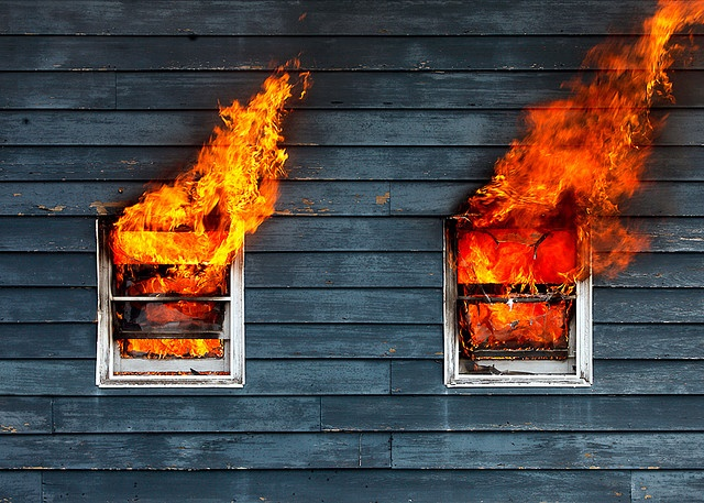Flames leap from a burning house outside of Belleville, Wisconsin. © 2009 Todd Klassy