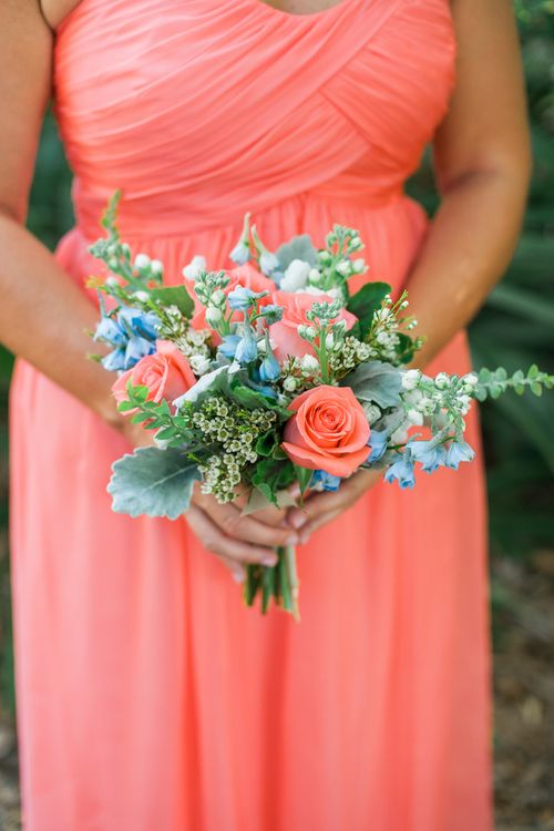 Charleston wedding - coral bridesmaids dreses and bouquet of bluebell, roses and dusty miller at Creek Club at I'On by Alyona Photography