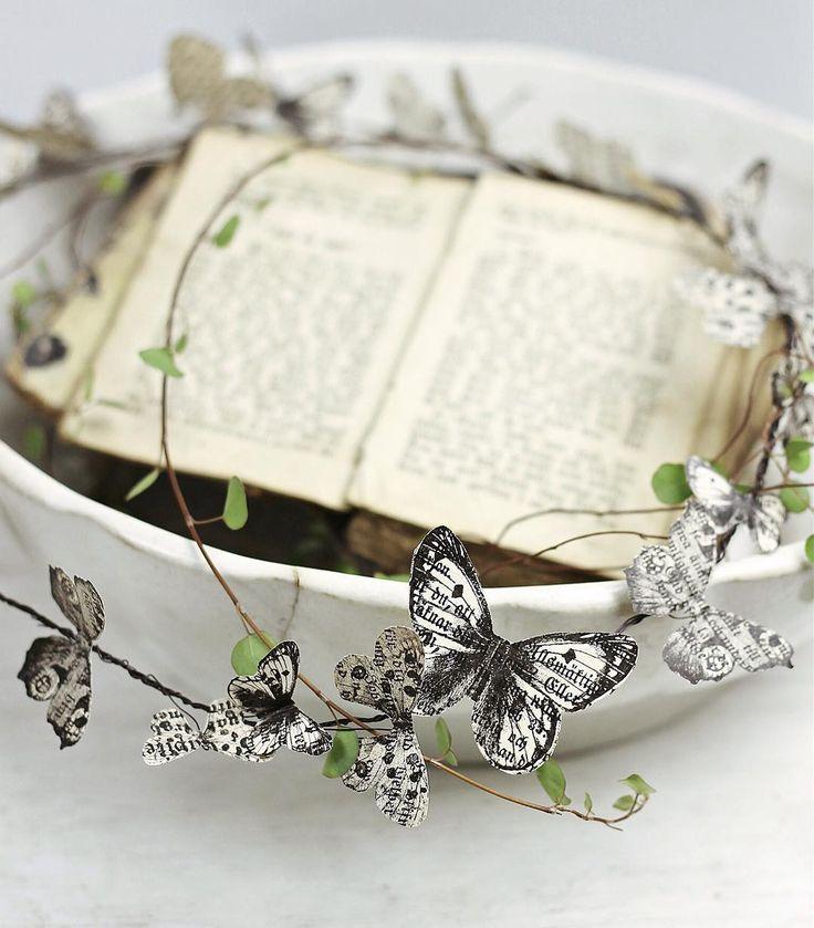 idemakeriet's photo on Instagram  - vlinders via de computer uitgeprint op oude boekpagina's, deze heb ik vervolgens uitgeknipt en toen met een heel dun ijzerdraadje bevestigd op een dun kransje. - butterfly
