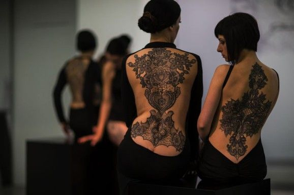 Sensual and tasteful lace tattoos by Marco Manzo exhibited at the Maxxi Museum in Roma, Italy.