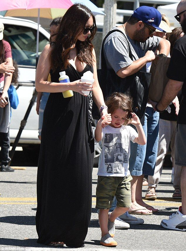 17 April 2016, Sunday, LA. Megan covered her blossoming baby bump with a black maxi dress, which showed some cleavage and had a monochrome belt above the waist. She also wore flip flops and appeared to be sporting just a touch of make-up under her sunglas