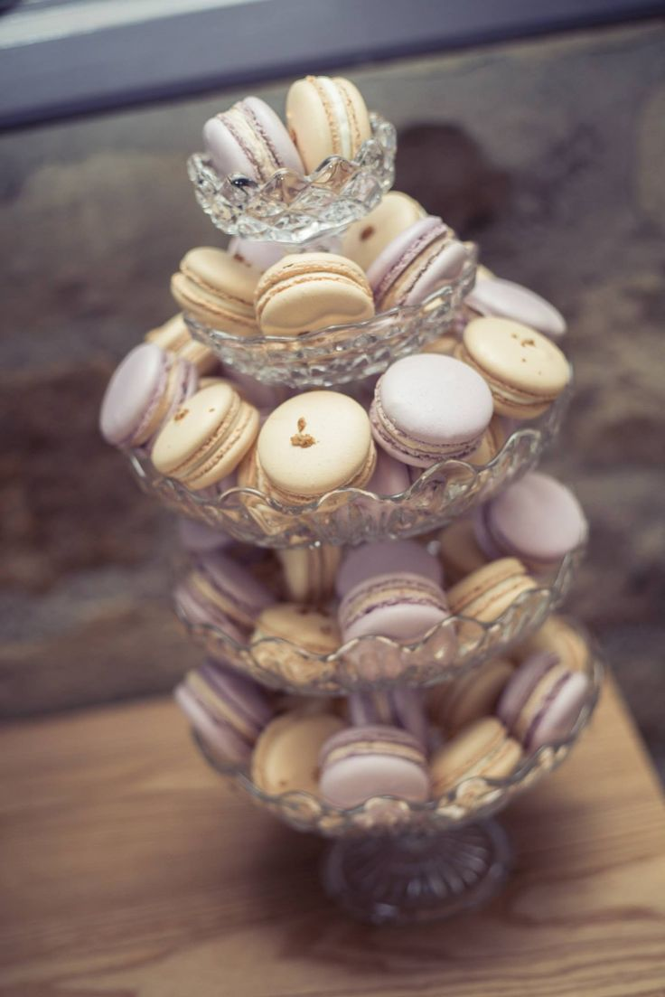 Vintage wedding macaron tower on stacked glass cake stands. Two flavours: plum, port & cinnamon and whisky, honey and oats.