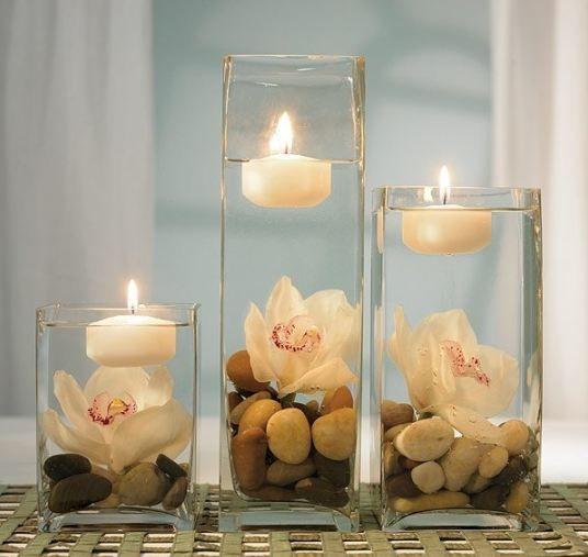 centrotavola con sassi e candele galleggianti