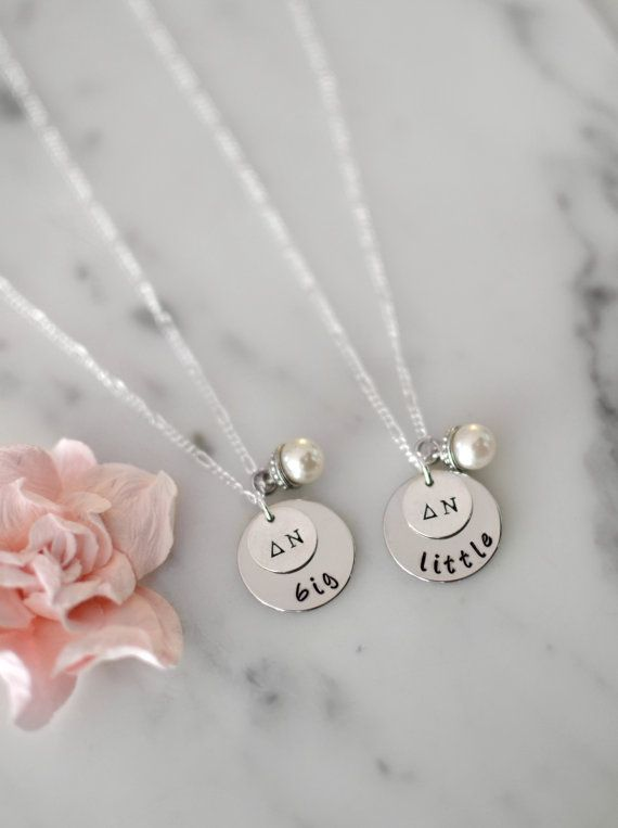✢ This sorority Big and Little necklace set is the perfect gift for an initiation or reveal basket! A pearl drop charm is the perfect finishing accent! Purchase of this item will include ✢ - (2) necklaces of your choice with pearl charms - (2) 1/2 sterling silver dipped blank or aluminum blank with Greek letters - (2) 3/4 aluminum OR nickel blanks with big/little ***Aluminum blanks are very lightweight, dont tarnish, and are a great alternative for nickel allergies! They al...