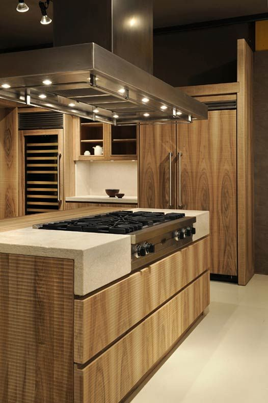 Custom made wooden kitchen with wine cellar and kitchen island. Light stone shelves. | #interiorDesign #handcraft #wood #furnishing #GiuseppeRivadossi