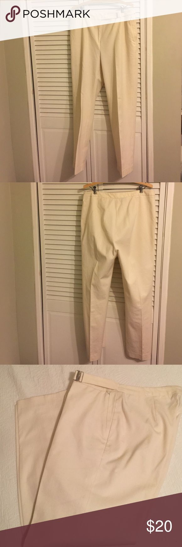 Lauren Ralph Lauren winter white slacks size 16 Beautiful winter white stretch Ralph Lauren slacks.  Zipper front;  two zipper closure slash pockets for a flat look on front;  very comfortable and a nice weight material;  self belt detail on front left (see picture).  Has been in my closet for awhile so needs a dry cleaning.  Price reflects the need to dry clean. Ralph Lauren Pants