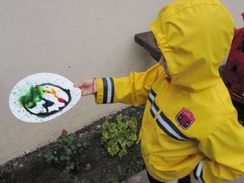 RAIN ART! The idea is simple: Sprinkle a few drops of food coloring on a paper plate, then gear up and head outside with plates in hand. As the raindrops hit the plate, colors mix and swirl and a one-of-a-kind creation is born!