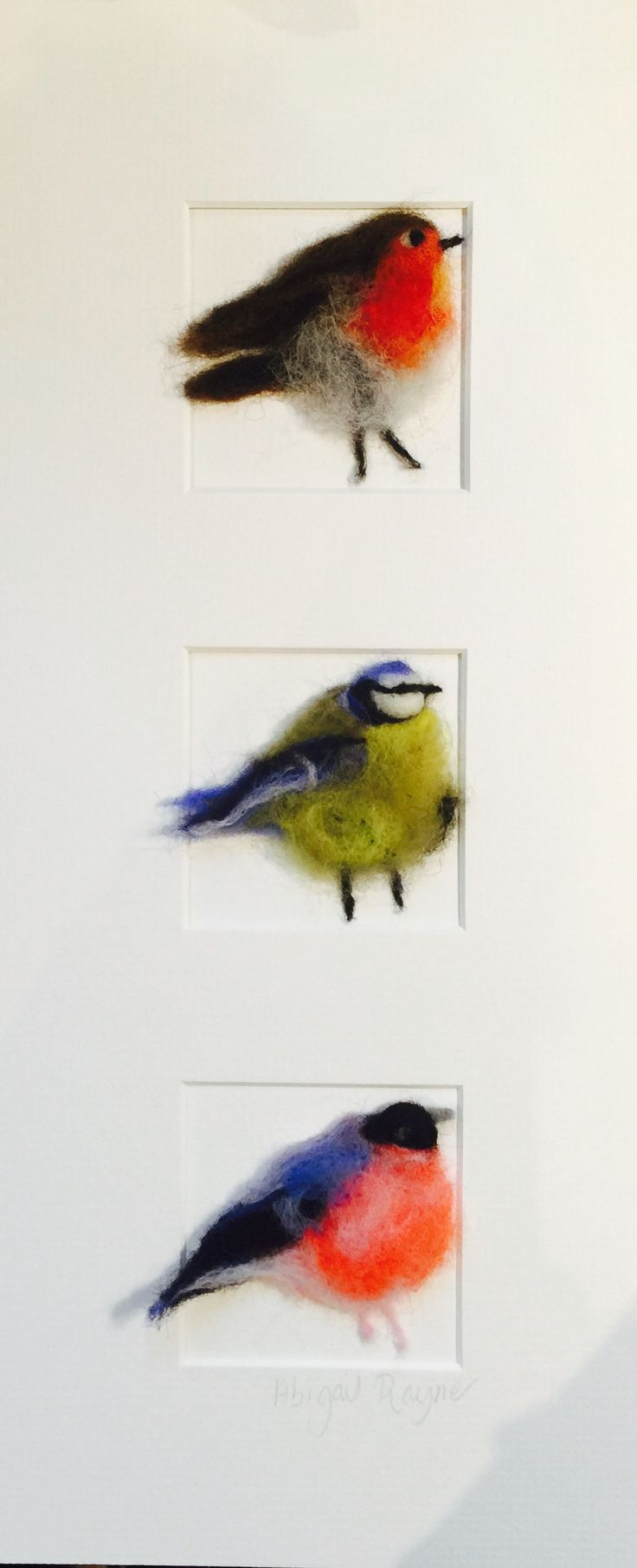 """A quirky, fun, three dimensional hand felted piece of wall art. Three different British garden birds, Robin, Bluetit and Bullfinch, so named """"three in a box"""". Would make a great picture for the kitchen or as a unique gift.Bespoke white wooden box frame, size 20 x 42 x 3.5cm deepDue to the bespoke handmade nature, each piece is unique, but equally as beautiful.Lead time approx 1-2 weeksCommission taken, please do email me so we can have a chat about what yo..."""