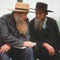 Men usually wear dark colored suits. They never wear belts, and mustache, because mustache is related to military. Young men are clean shaved before marriage, and married men grow beards after marriage, because beards are marks of adult Amish men.
