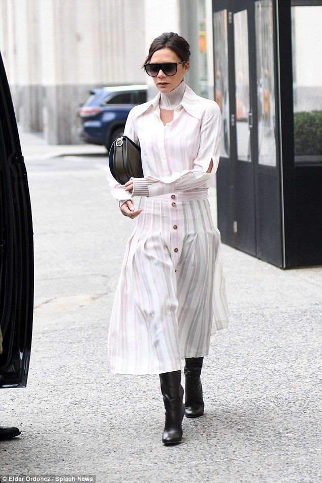 Victoria Beckham was spotted in a stunning white and pink shirt and pleated skirt as she stepped out with husband David in New York City after celebrating son Brooklyn's 19th birthday.