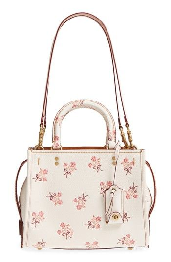 Free shipping and returns on COACH 1941 Floral Bow Rogue 25 Leather Satchel at Nordstrom.com. A vintage-inspired embossed floral motif adds fresh-picked appeal to a smaller version of a fan-favorite COACH satchel. The style retains the structured silhouette of the original and is topped with molded grasp handles and longer over-the-shoulder handles for carrying convenience.