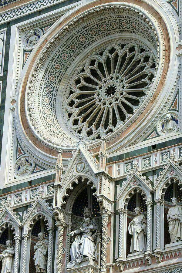 Architectural details of Cattedrale di Santa Maria del Fiore in Florence, Italy. Il Duomo di Firenze, as it is ordinarily called, was begun in 1296 in the Gothic style with the design of Arnolfo di Cambio. Photography by: Kieran Brimson