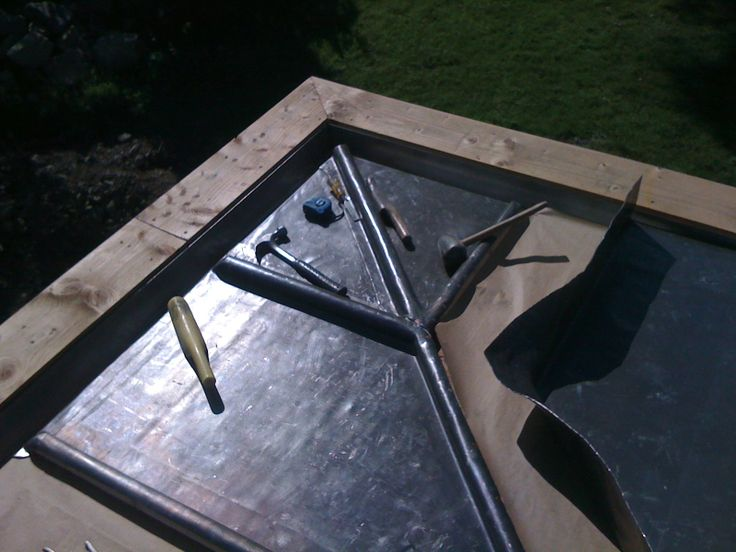 The leadworker's craft (and tools) on our Hawkshead roof.