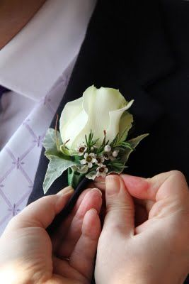 A more classic white rose buttonhole - maybe with black ribbon?