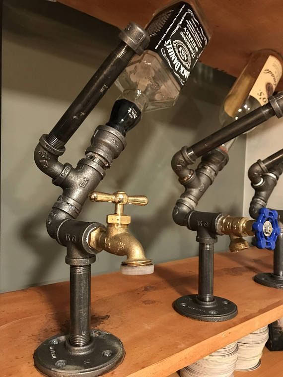 Black Iron pipe liquor dispenser with unique brass spout along with air release cap to prevent vacuum air pocket effect. Comes with 4 screws to mount anywhere on a horizontal surface. Can customize caps for specific liquors upon request or use a Jack cap as it fits most screw top