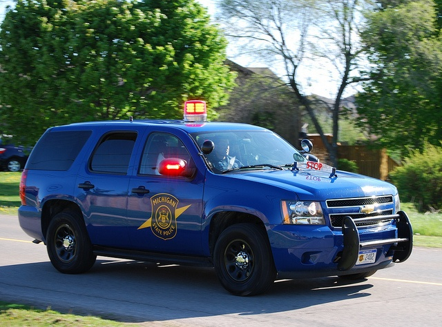 Michigan State Police Tahoe. Awful light bar, but hey they had it forever...