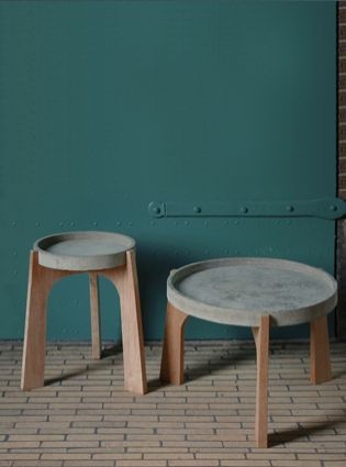Renate Vos – Ruimtelijk ontwerp Coffee table and side table [/or stool] for indoor and outdoor use. The base is made of oak and they have a concrete table top, which can be reversed. Inside you use the rimmed top, outside you use the smooth 'underside' so that the rainwater won't remain on the surface.
