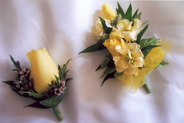 Yellow themed corsage and boutonniere created at Lexington Floral in Shoreview, MN.