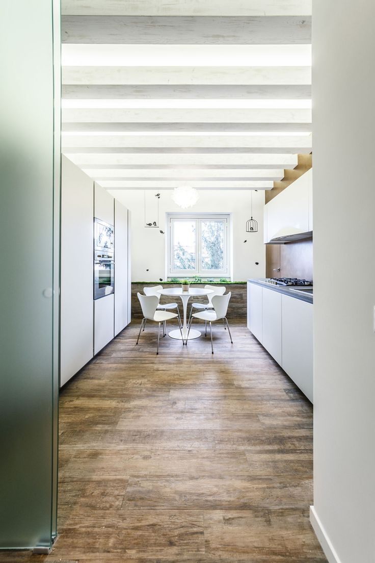 Lovely White Apartment Spiced Up with Natural Green Details | http://www.designrulz.com/design/2015/10/lovely-white-apartment-spiced-up-with-natural-green-details/