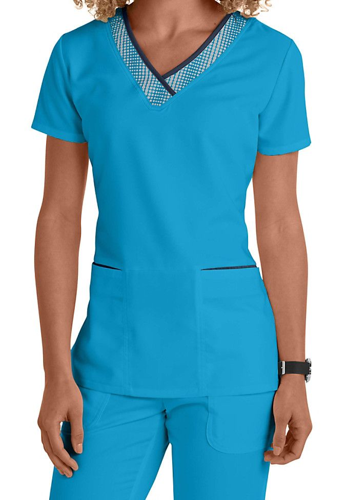 The detailing on the neckline of this Grey's Anatomy v-neck grid trim top put a sporty spin on a classic top! Shown in Blueberry