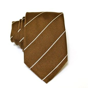 Jacquard tie, 100% silk, brown with single and double oblique white stripes. Ideal for less formal occasions but also special occasions. Pattern and color of this elegant tie can fit with any outfit.