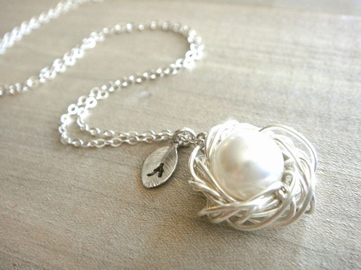 Personalized Bird's Nest Pendant - This beautiful necklace features a bird nest handmade out of sterling silver and a large white Swarovski pearl. The wire has been wrapped haphazardly to imitate the natural look. The pendant is approximately 2 cm in diameter and sits on a 17 in. sterling silver chain. It's such a unique piece of jewelry and would be a wonderful gift for Mom.