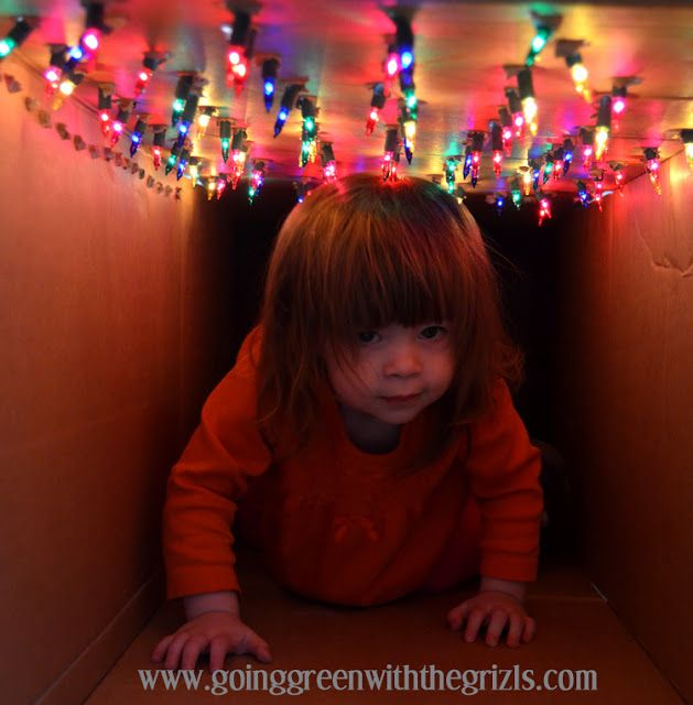 Need a good free or cheap activity to keep kids occupied indoors during the winter? Seriously easy and entertained our toddler for a solid month. Check out the other tutorials on the site--they're gold! DIY Light Tunnel For Your Kiddos - Going Green with the Grizls