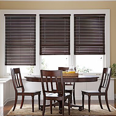 like the dark wood blinds against white trim for the upstairs bedrooms