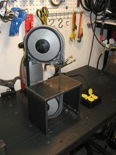 Metal Portable Band Saw being used with a 'Vertical' Tabletop Stand