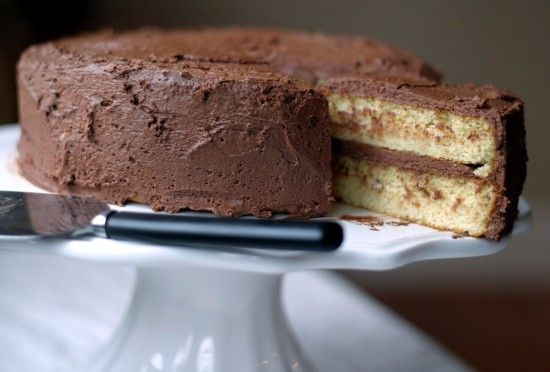 {Paleo} Yellow cake made with almond flour. Cake was yummy! I made a two-layer cake. I used almond meal, so my cake was a bit darker than in the picture. It still sank in the middle too. I filled it in with Paleo chocolate frosting. I'll make this cake again.
