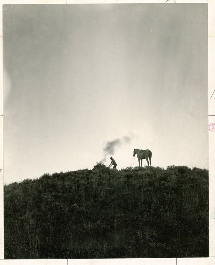 A Native American sends smoke signals in Montana, June 1909. Photograph by Dr. Joseph K. Dixon