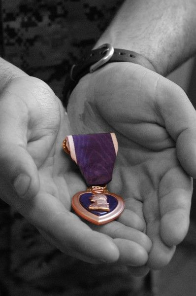 Husband in for 27 yrs = no Purple Hearts/Son in for 7 yrs = 2 Purple Hearts~