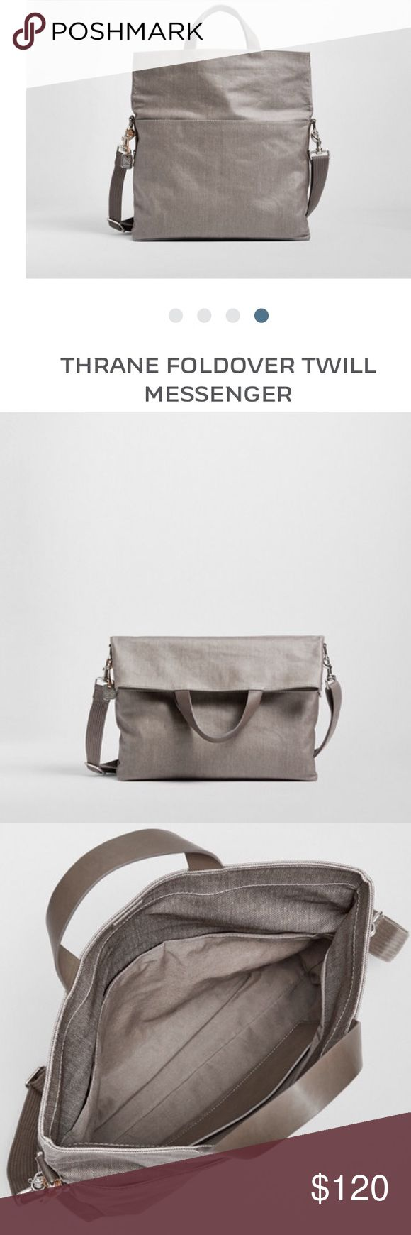 """Skagen Thrane fold over messenger bag The Thrane features a spacious interior packed with pockets and compartments. Lift the foldover flap to carry as a tote, exposing a slip pocket on the front and a zip pocket on the back. The bag's main compartment contains a padded 15-inch laptop sleeve, two slip pockets and a pen holder. Where coated, the bag's twill material is resistant to water.Material:Twill-100% cotton. Leather Grab handle. 27.56"""" Shoulder Drop. Worn once. Has marker line inside to…"""