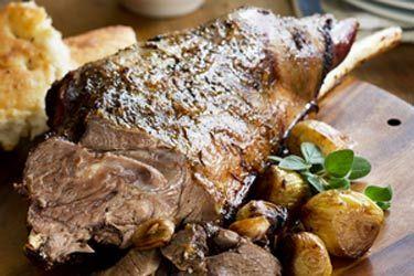 Roast goat leg with garlic and marjoram