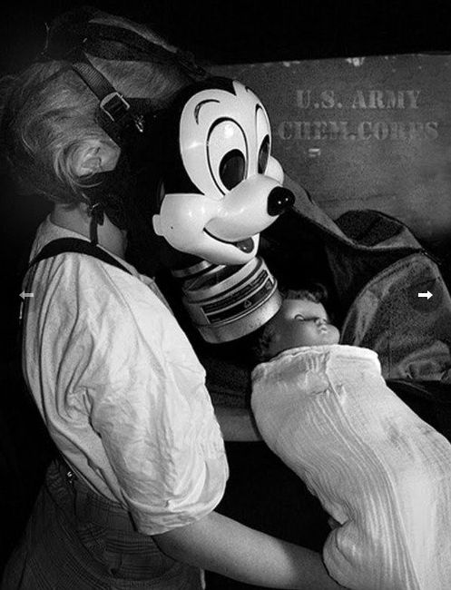 WW II era Mickey Mouse gas mask produced by the Sun Rubber Products Company, which previously made rubber squeak toys and dolls