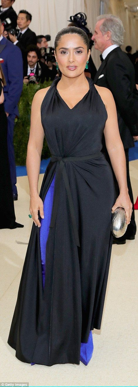 Salma Hayek, as always, played up her hourglass figure in a cinched-at-the-waist Balenciag...